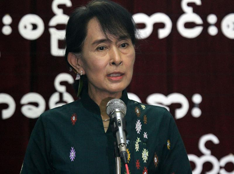 Myanmar opposition leader Aung San Suu Kyi speaks about her trip to the United States during a press conference at the headquarters of her National League for Democracy Party in Yangon, Myanmar, Monday, Oct. 8, 2012. (AP Photo/Khin Maung Win)