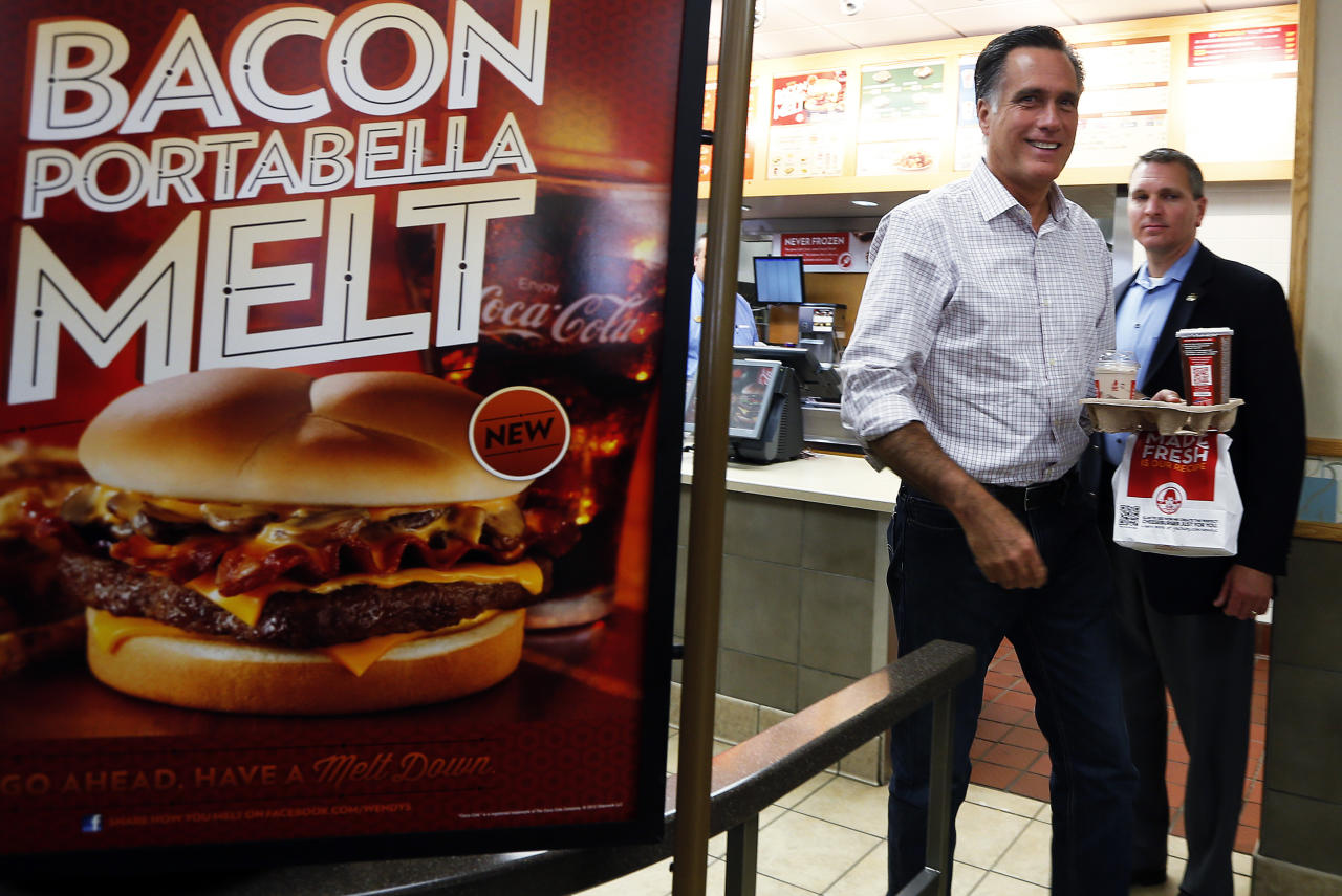 Republican presidential nominee Mitt Romney takes out his food from a  Wendy's restaurant in Cuyahoga Falls, Ohio October 9, 2012.   REUTERS/Shannon Stapleton (UNITED STATES - Tags: POLITICS ELECTIONS USA PRESIDENTIAL ELECTION)