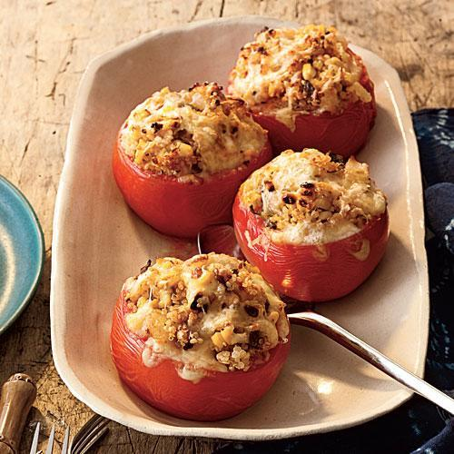 """<p>These tomatoes are stuffed full with super healthy quinoa, sweet fresh corn, poblano chiles, and lots of shredded cheese. Fresh lime juice adds a burst of citrus freshness. It's a delicious side or meatless main.</p> <p> <a rel=""""nofollow noopener"""" href=""""http://www.myrecipes.com/recipe/baked-tomatoes"""" target=""""_blank"""" data-ylk=""""slk:View Recipe: Baked Tomatoes with Quinoa, Corn, and Green Chiles"""" class=""""link rapid-noclick-resp"""">View Recipe: Baked Tomatoes with Quinoa, Corn, and Green Chiles</a></p>"""