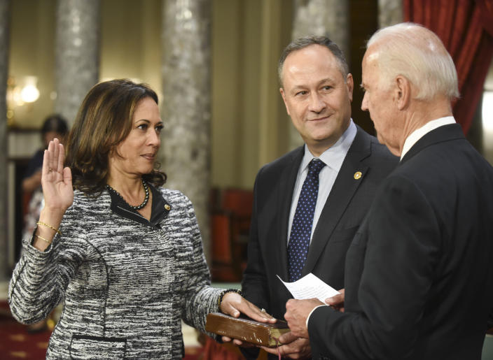 Vice President Joe Biden administers the Senate oath of office to Harris, as her husband holds the Bible, on Jan. 3, 2017. (Kevin Wolf/AP)