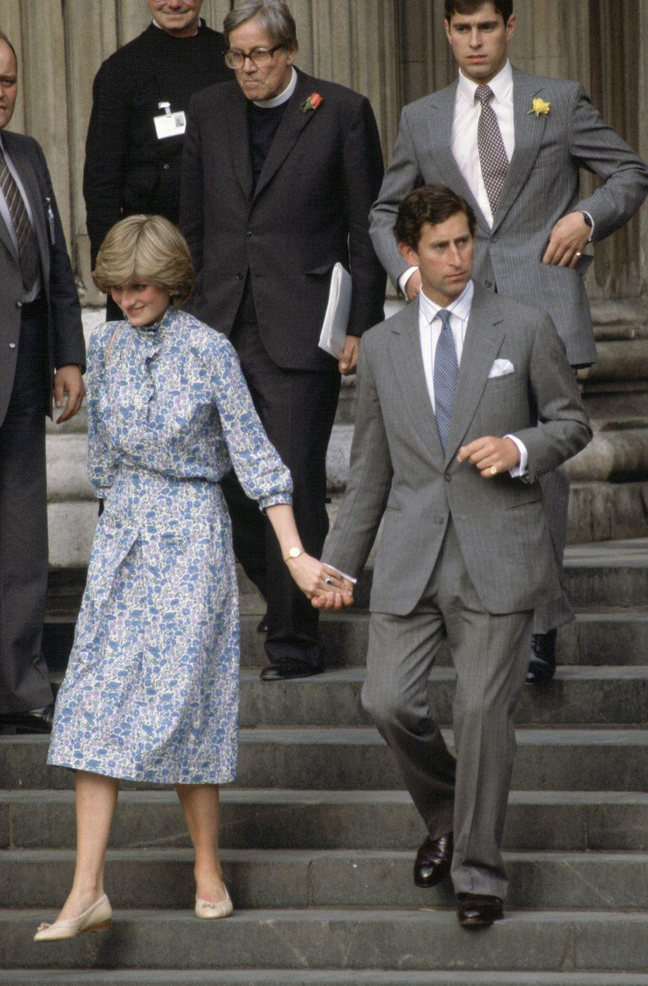 <p>The almost-bride-and-groom photographed leaving St. Paul's Cathedral after their wedding rehearsal, with Prince Andrew behind them on the steps.</p>