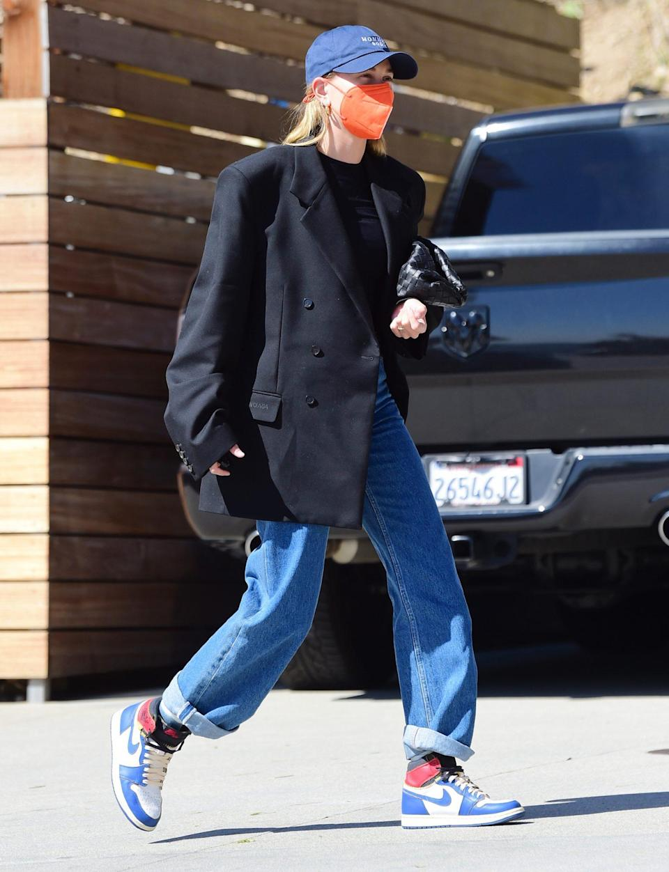 <p>Hailey Bieber wears an oversized Balenciaga blazer while out and about in Santa Monica on Thursday. </p>