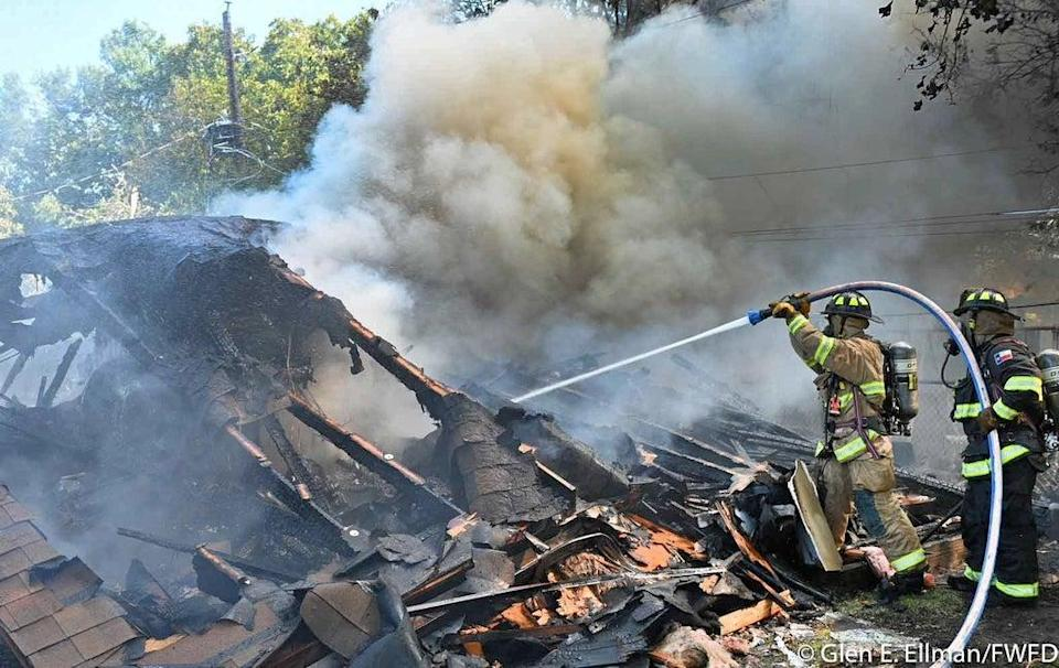 Two Navy pilots were injured after ejecting as their plane crashed in the North Texas neighbourhood of Lake Worth (Glen E. Ellman/FWFD)