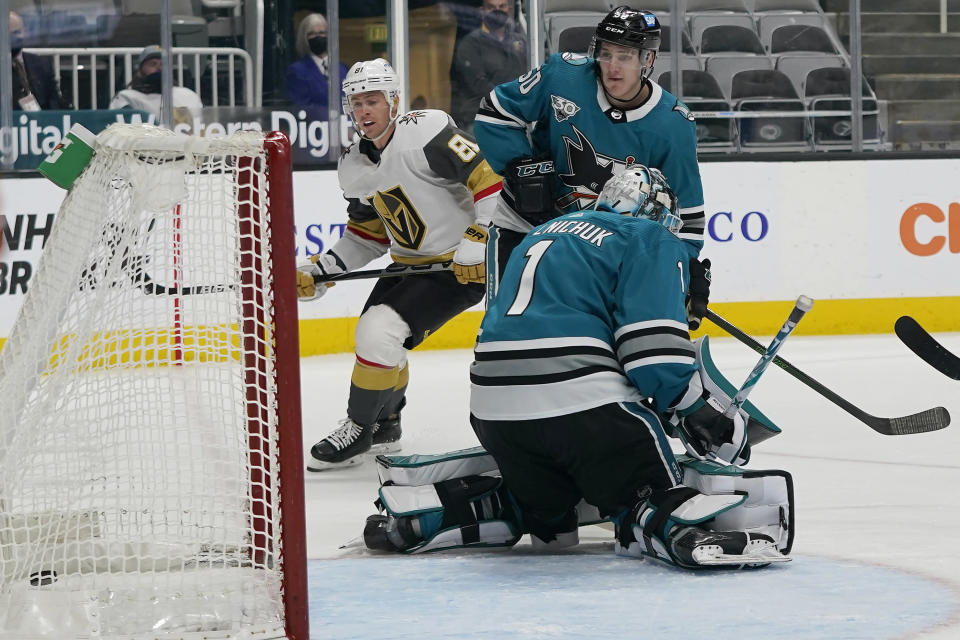FILE - Vegas Golden Knights center Jonathan Marchessault, left, looks toward the goal after scoring past San Jose Sharks goaltender Alexei Melnichuk (1) during the first period of an NHL hockey game in San Jose, Calif., in this Wednesday, May 12, 2021, file photo. The butterfly style of goalies going down on their knees to stop the puck has completely taken over hockey, and specialized coaching and video helped them fix perceived weaknesses better than ever before. (AP Photo/Jeff Chiu, File)