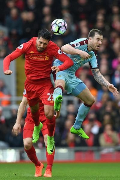 Liverpool's midfielder Emre Can (L) vies with Burnley's striker Ashley Barnes during the English Premier League football match between Liverpool and Burnley at Anfield in Liverpool, north west England on March 12, 2017