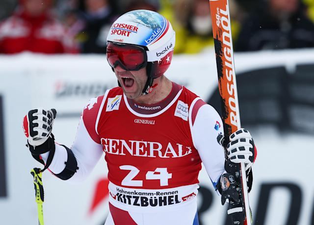 Didier Defago of Switzerland celebrates as he crosses the finish line to win an alpine ski men's World Cup Super G in Kitzbuehel, Austria, Saunday, Jan. 26, 2014. (AP Photo/Giovanni Auletta)