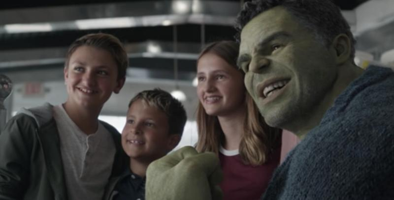 Professor Hulk surrounded by some tiny Avengers groupies