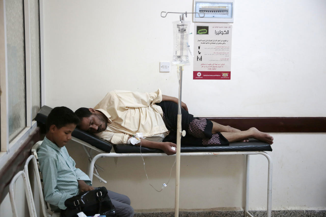 FILE - In this Saturday, July 1, 2017, file photo, a man is treated for suspected cholera infection at a hospital in Sanaa, Yemen. Since April, a cholera epidemic has ravaged the country with around 400,000 suspected cases and over 1,800 deaths. The rainy season underway threatens to worsen the situation and the number of cholera cases is expected to double by the end of the year, according to ICRC. (AP Photo/Hani Mohammed, File)