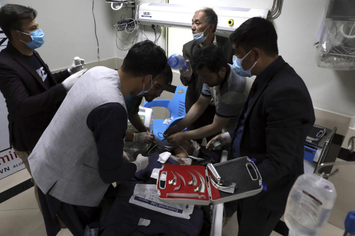 An Afghan school student treated at a hospital after a bomb explosion near a school in west of Kabul, Afghanistan, Saturday, May 8, 2021. A bomb exploded near a school in west Kabul on Saturday, killing several people, many them young students, an Afghan government spokesmen said. (AP Photo/Rahmat Gul)