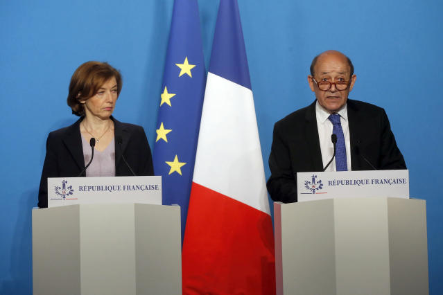 <p>French Minister for Foreign Affairs Jean-Yves Le Drian, right, and French Defense Minister Florence Parly give an official statement in the press room after attending an emergency meeting with French President Emmanuel Macron at the Elysee Palace, in Paris, France, Saturday, April 14, 2018. (Photo: Michel Euler, Pool/AP) </p>