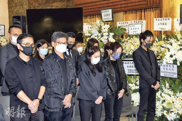 Family members and friends paid their respects to the late Ng Man Tat