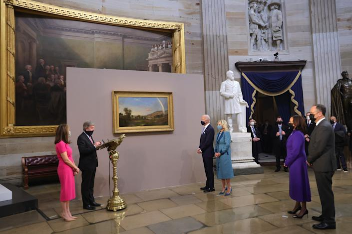 President Joe Biden and First Lady Dr. Jill Biden presented painting from Sen. Roy Blunt (R-MO), as Vice President Kamala Harris and Doug Emhoff look on, in the Capitol Rotunda after the inauguration of U.S. President Joe Biden on the West Front of the U.S. Capitol on January 20, 2021 in Washington, DC.  (Win McNamee/Getty Images)
