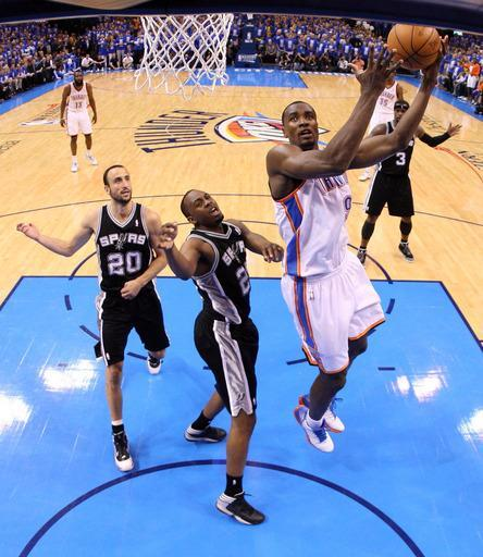 OKLAHOMA CITY, OK - MAY 31: Serge Ibaka #9 of the Oklahoma City Thunder goes up for a shot against James Anderson #25 of the San Antonio Spurs in Game Five of the Western Conference Finals of the 2012 NBA Playoffs at Chesapeake Energy Arena on May 31, 2012 in Oklahoma City, Oklahoma. (Photo by Ronald Martinez/Getty Images)