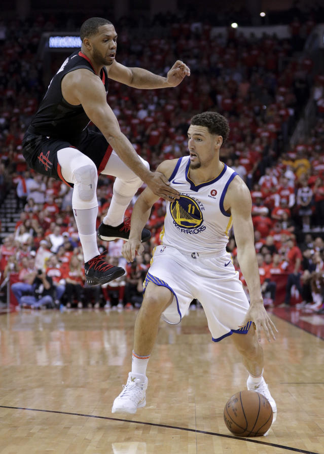 Houston Rockets guard Eric Gordon, left, guards Golden State Warriors guard Klay Thompson during the first half in Game 5 of the NBA basketball playoffs Western Conference finals in Houston, Thursday, May 24, 2018. (AP Photo/David J. Phillip)