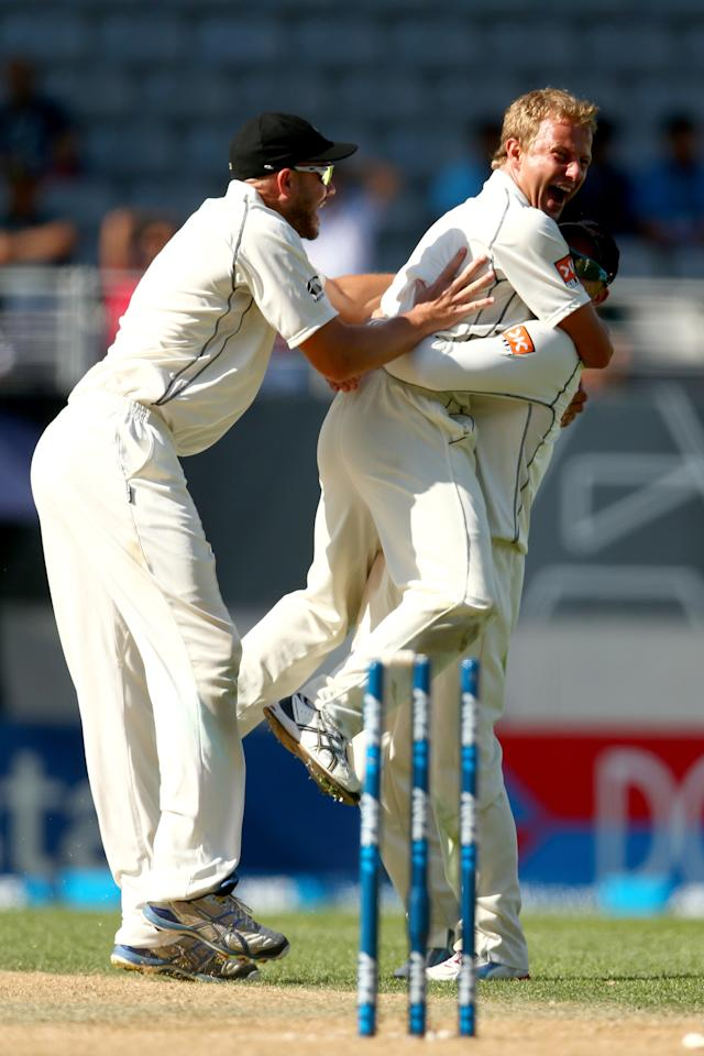 AUCKLAND, NEW ZEALAND - FEBRUARY 09:  Neil Wagner of New Zealand is lifted by Brendon McCullum as he celebrates his wicket of MS Dhoni of India during day four of the First Test match between New Zealand and India at Eden Park on February 9, 2014 in Auckland, New Zealand.  (Photo by Phil Walter/Getty Images)