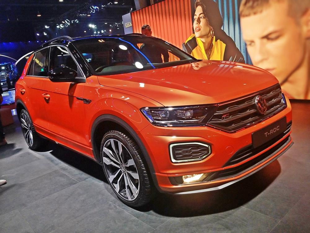 The T-Roc is a sporty SUV that will sit below the Tiguan. While the Tiguan is a more family-focused SUV, the T-Roc is sportier. The car on display has a distinctive orange paint and the added sporty elements looks good, too.