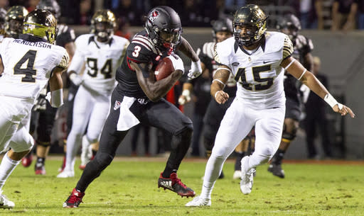 North Carolina State's Kelvin Harmon (3) carries the ball after making a catch ahead of Wake Forest's Ryan Smenda Jr. (45) during the first half of an NCAA college football game in Raleigh, N.C., Thursday, Nov. 8, 2018. (AP Photo/Ben McKeown)