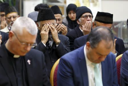 Father David Pennells of Mitcham Parish Church, attends a remembrance service for the victims of the recent attack in Westminster, at the Baitul Futuh Mosque, in south west London, Britain March 24, 2017.     REUTERS/Peter Nicholls