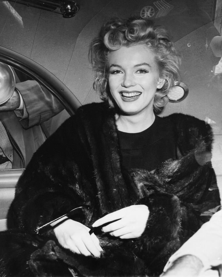 "FILE - In this June 2, unknown year, file photo, actress Marilyn Monroe smiles in a car after arriving tousled from an all-night plane flight from Hollywood to Idlewild Airport, in New York. She said she planned to rest in New York before going to England to make a new movie with Sir Laurence Olivier. Sidestepping questions as to whether she and playwright Arthur Miller plan to wed, she said: ""No comment, we're really good friends."" (AP Photo, File)"