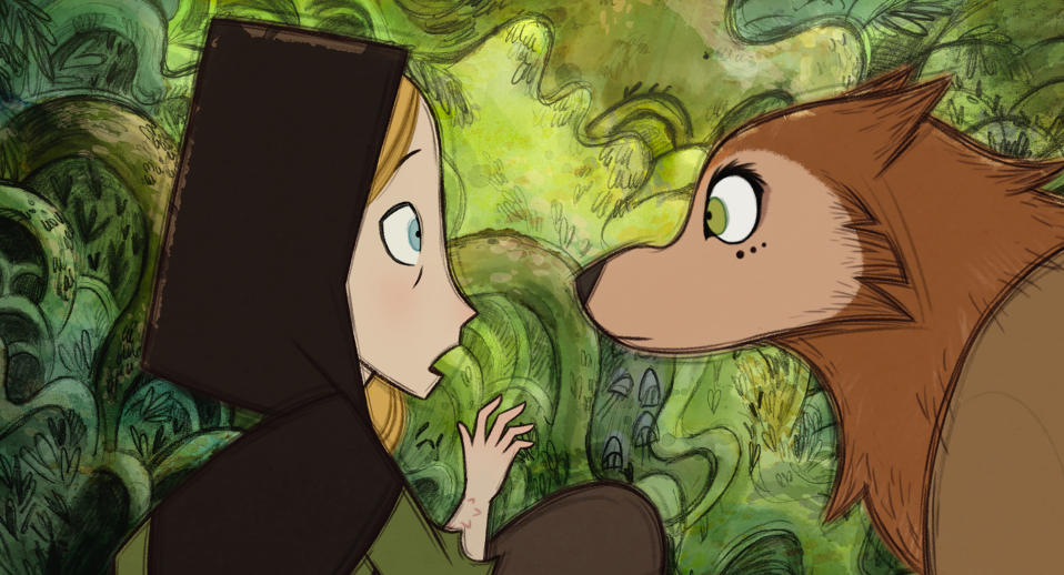 """This image released by Apple shows Robyn Goodfellowe, voiced by Honor Kneafsey, left, and Mebh Óg Mactíre, voiced by Eva Whittaker, in """"Wolfwalkers."""" (Apple via AP)"""
