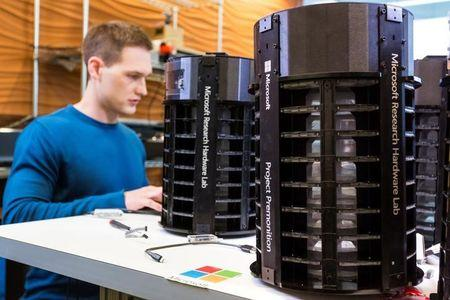 Microsoft Researcher Ethan Jackson works on the AI technology that the drives Project Premonition mosquito trap