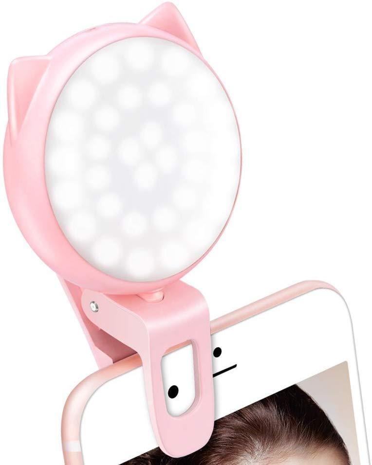 """We all know everyone is going to take the selfie anyway, there might as well be good lighting. <br><br><strong>Ourry</strong> Selfie Light Ring for iPhone and Camera, $, available at <a href=""""https://www.amazon.com/Rechargeable-Battery-Brightness-Operated-Portable/dp/B076HNN73B/"""" rel=""""nofollow noopener"""" target=""""_blank"""" data-ylk=""""slk:Amazon"""" class=""""link rapid-noclick-resp"""">Amazon</a>"""