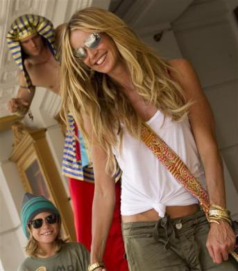 Elle Macpherson and her son Cy, are pictured at the entrance of the Revenge of the Mummy attraction during their visit to Universal Orlando Resort in Orlando, August 24, 2011.