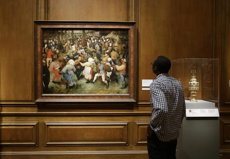 In a June 13, 2013 photo, The Wedding Dance by Pieter Bruegel the Elder is displayed at the Detroit Institute of Arts in Detroit. In a quest to balance the budget in cash-strapped Detroit, the city's emergency manager is proposing a controversial idea: sell the city's art. (AP Photo/Carlos Osorio)