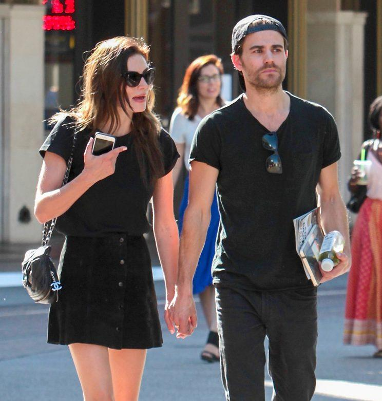 Phoebe Tonkin and Paul Wesley hold hands