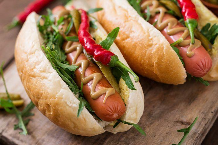 <p>If you get your water boiling first, you can just about get your hotdog simmered in three minutes (okay, you might need a tiny weeny extra minute). Chuck in a roll, add mustard, salad, chillies – whatever you want – and Bob's your uncle. <i>[Picture: Getty]</i></p>