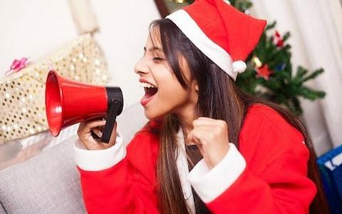 Illustration of someone with a megaphone at Christmas