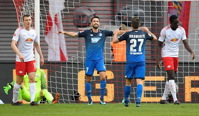 Soccer Football - Bundesliga - RB Leipzig vs TSG 1899 Hoffenheim - Red Bull Arena, Leipzig, Germany - April 21, 2018 Hoffenheim's Lukas Rupp celebrates scoring their fifth goal with Andrej Kramaric REUTERS/Matthias Rietschel DFL RULES TO LIMIT THE ONLINE USAGE DURING MATCH TIME TO 15 PICTURES PER GAME. IMAGE SEQUENCES TO SIMULATE VIDEO IS NOT ALLOWED AT ANY TIME. FOR FURTHER QUERIES PLEASE CONTACT DFL DIRECTLY AT + 49 69 650050