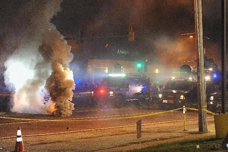 Law enforcement fires tear gas on protesters in Ferguson, Missouri on August 18, 2014 (AFP Photo/Michael B. Thomas)