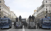 Riot police block a street to protect against Belarusian opposition supporters rally in Minsk, Belarus, Sunday, Sept. 6, 2020. Sunday's demonstration marked the beginning of the fifth week of daily protests calling for Belarusian President Alexander Lukashenko's resignation in the wake of allegedly manipulated elections. (AP Photo/TUT.by)