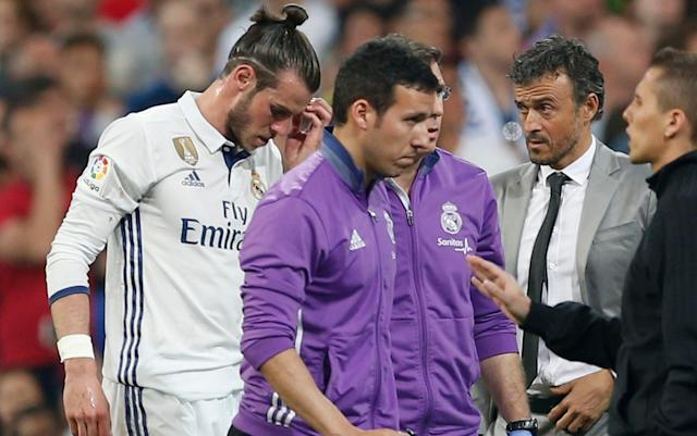 <span>Bale leaves the field of play after Barcelona</span> <span>Credit: AP </span>