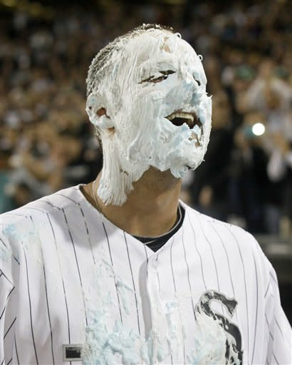 Chicago White Sox's Jordan Danks reacts after getting a shaving cream pie in his face from Alexei Ramirez, for Danks' walk-off home run that gave Chicago a 4-3 win over the Oakland Athletics in a baseball game Friday, Aug. 10, 2012, in Chicago. (AP Photo/Charles Rex Arbogast)