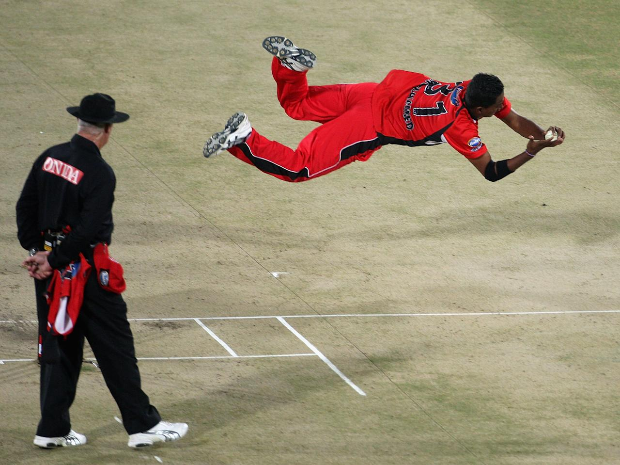HYDERABAD, INDIA - OCTOBER 22:  Dave Mohammed of Trinidad takes a catch to dismiss Henry Davids of Cobras during the Airtel Champions League Twenty20 Second Semi Final between Cape Cobras and Trinidad and Tobago at the Rajiv Gandhi International Stadium on October 22, 2009 in Hyderabad, India.  (Photo by Hamish Blair - GCV/GCV via Getty Images)