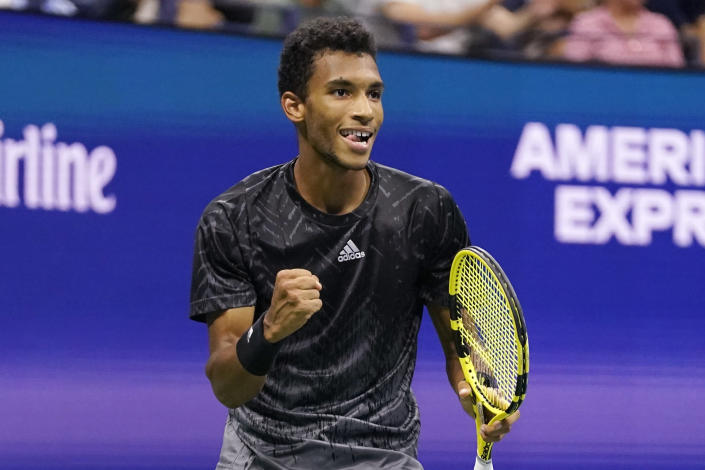 Felix Auger-Aliassime, of Canada, reacts after winning the third set against Frances Tiafoe, of the United States, during the fourth round of the US Open tennis championships, Sunday, Sept. 5 2021, in New York. (AP Photo/Frank Franklin II)
