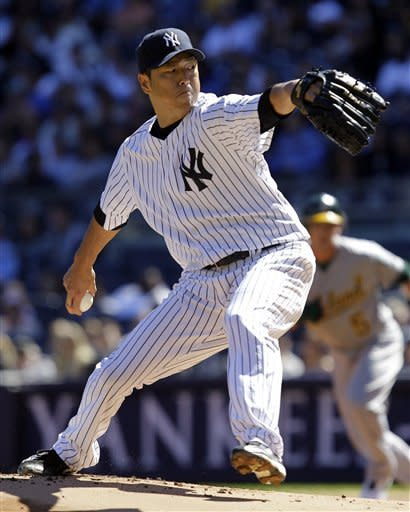 New York Yankees starting pitcher Hiroki Kuroda delivers in the first inning against the Oakland Athletics in their baseball game at Yankee Stadium in New York, Sunday, Sept. 23, 2012. (AP Photo/Kathy Willens)