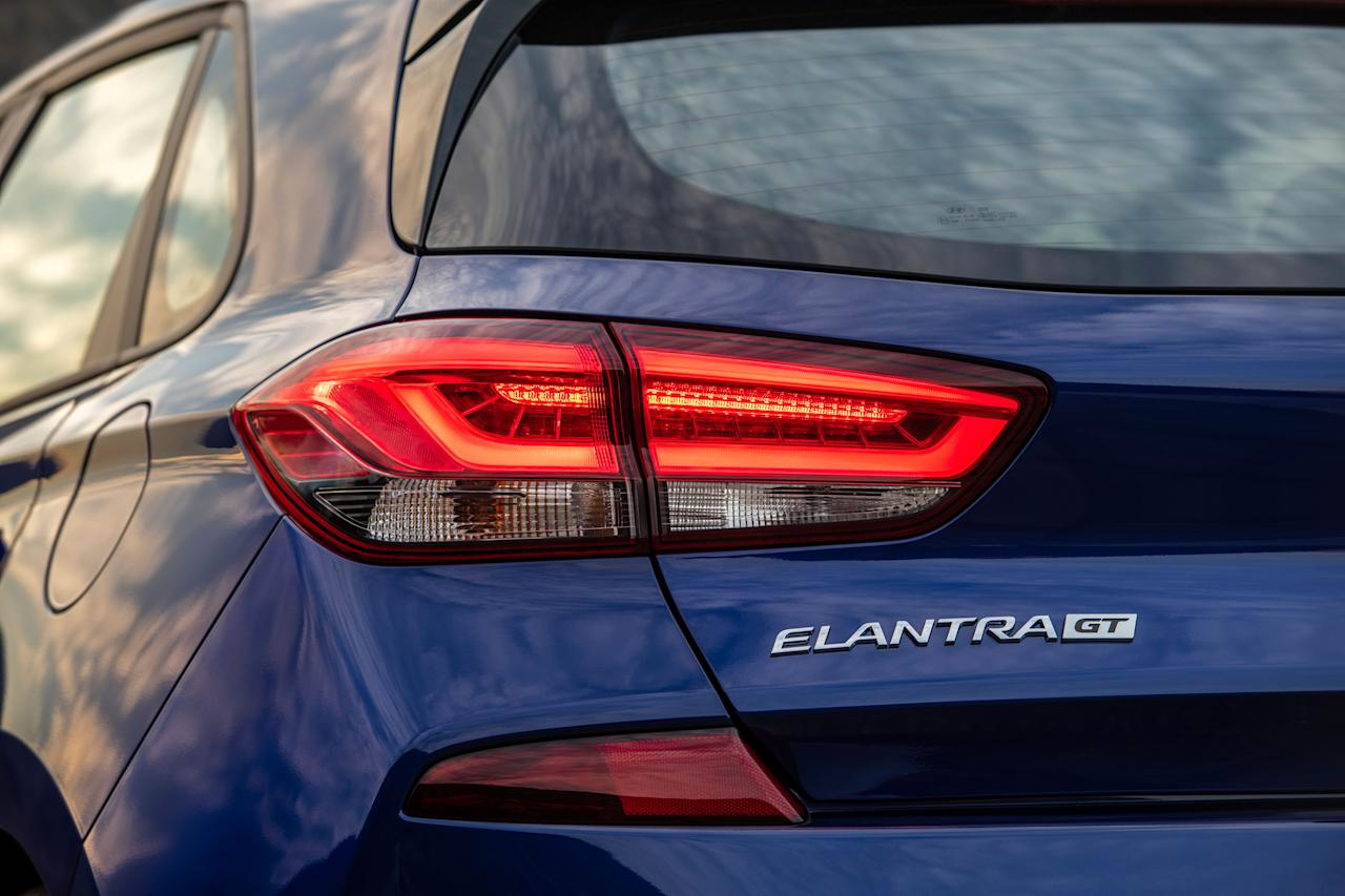 "<p>At first glance, it might seem that the new 2019 Hyundai Elantra GT N Line is merely an appearance package that imitates the brand's N performance models, but it actually replaces <a rel=""nofollow"" href=""https://www.caranddriver.com/hyundai/elantra-gt-sport"">the existing Elantra GT Sport</a> in the Elantra lineup as the hottest version of Hyundai's Europe-derived hatchback (known as the i30 overseas) that is available to us Americans. While that GT Sport model looked nearly identical to <a rel=""nofollow"" href=""https://www.caranddriver.com/hyundai/elantra-gt"">the regular non-turbo Elantra GT</a>, the new N Line trim does bring more aggressive body styling that is taken from <a rel=""nofollow"" href=""https://www.caranddriver.com/reviews/2018-hyundai-i30-n-first-drive-review"">the Euro-only i30 N hot hatch</a>-and it brings real performance modifications, too.</p>"