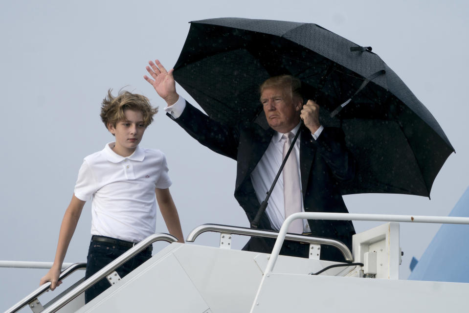 <em>President Trump also left his son Barron exposed to the elements (AP)</em>