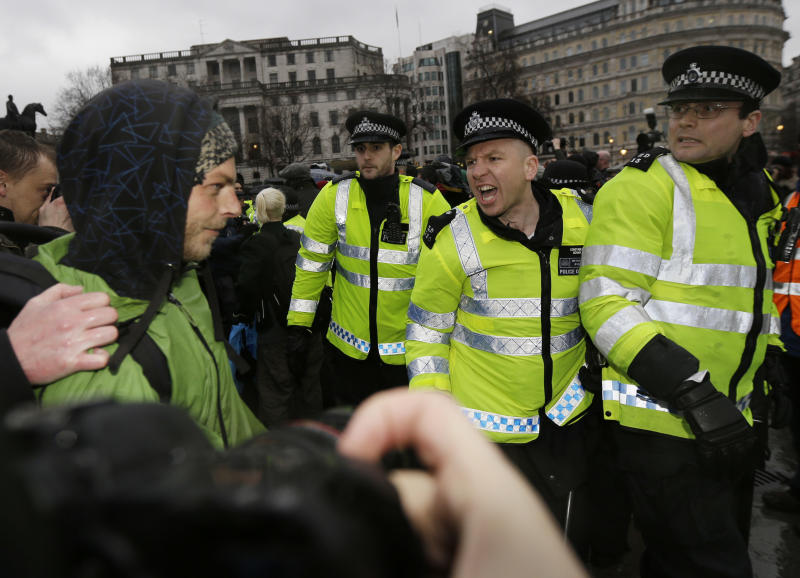 "British police officers scuffle with people gathered in central London's Trafalgar square, Saturday, April 13, 2013, with a party to mark the death of former British Prime Minister Margaret Thatcher. Margaret Thatcher, the combative ""Iron Lady"" who transformed her country by a ruthless dedication to free market economy during her 11-years as prime minister, died Monday, April 8, 2013. She was 87. (AP Photo/Lefteris Pitarakis)"