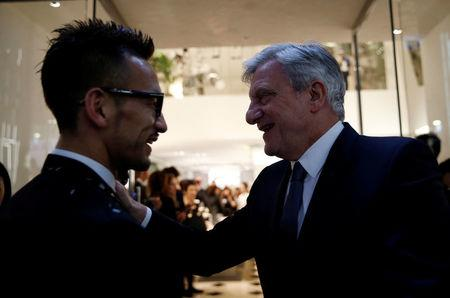Christian Dior Chief Executive Sidney Toledano meets former Japanese soccer player Hidetoshi Nakata at Dior's new flagship store in Tokyo, Japan, April 19, 2017.      REUTERS/Toru Hanai