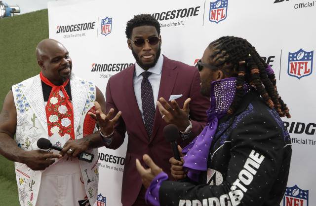 Vince Wilfork, left and DeAngelo Williams, right, speaks with Florida State defensive end Brian Burns on the red carpet ahead of the first round at the NFL football draft, Thursday, April 25, 2019, in Nashville, Tenn. (AP Photo/Steve Helber)