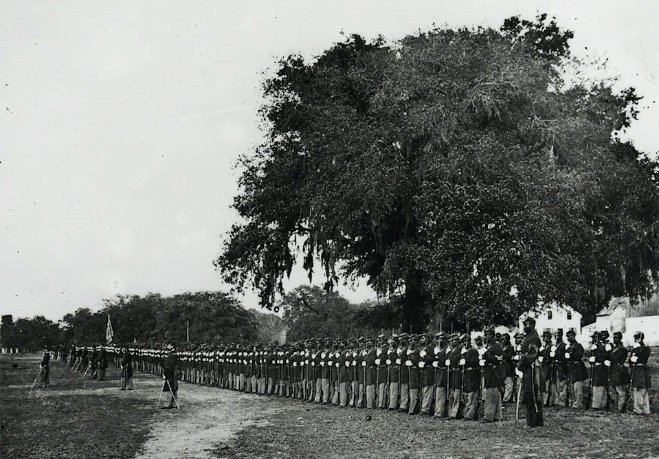 A Black Civil War unit assembled to hear a reading of President Abraham Lincoln's Emancipation Proclamation in 1863.