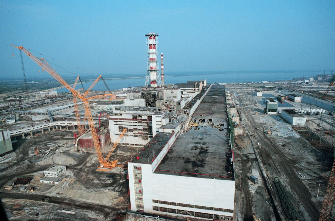 383331 01: Heavy equipment surrounds the Chernobyl nuclear plant May 1, 1986 in Russia. Safety work is being done on block nr. 4 of the plant after an explosion caused massive leakage of radioactive gas into the environment. (Photo by Laski Diffusion/Liaison)