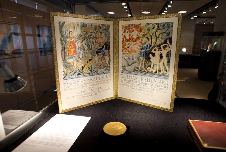 """William Faulkner's Nobel Prize medal for Literature is displayed at Sotheby's in New York on June 6, 2013. The items are part of the """"Fine Books and Manuscripts, Including Americana"""" collection, to be auctioned starting next week"""