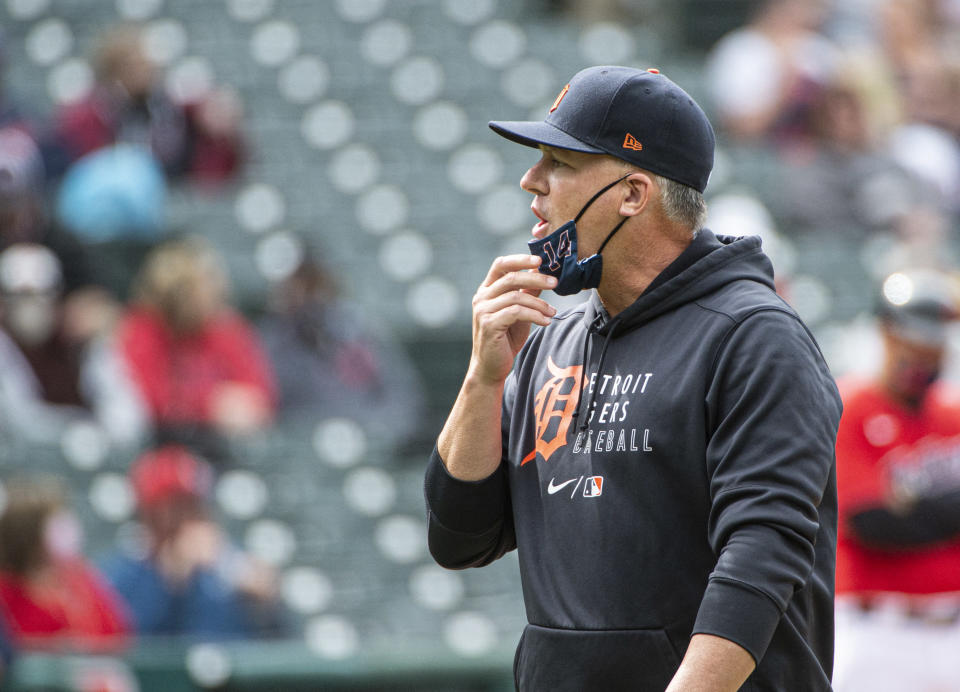 Detroit Tigers manager A.J. Hinch walks back to the dugout after making a pitching change during the eighth inning of a baseball game against the Cleveland Indians in Cleveland, Sunday, April 11, 2021. (AP Photo/Phil Long)