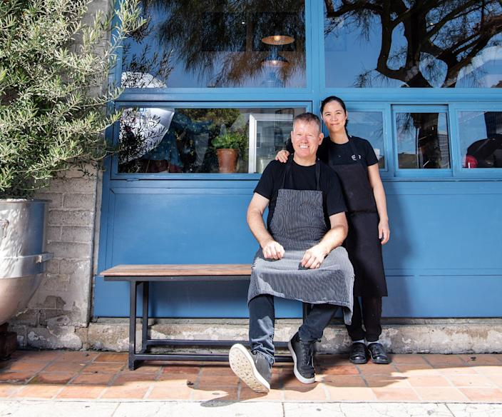 """Chefs Walter and Margarita Manzke of République in front of the restaurant's takeout window, now used for pastry and coffee service. <span class=""""copyright"""">(Mariah Tauger / Los Angeles Times)</span>"""