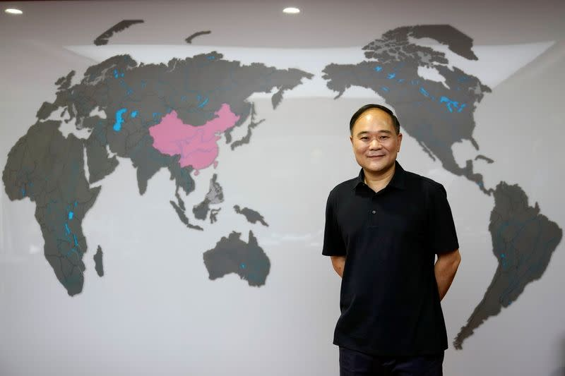 Zhejiang Geely Holding Group's Chairman Li Shufu poses for pictures at his office in Hangzhou